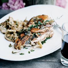 Grilled Chicken Breasts with Sautéed Mushrooms | Before grilling chicken, Francis Mallmann tucks orange zest and just-picked oregano under the skin. The fresh flavor is amazing with the crispy, smoky bird.