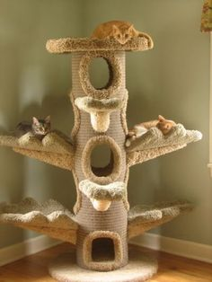 This is one of the craziest cat trees we have ever seen! This would be great for a multi-cat home. It is so important for cats to have vertical spaces, especially with multiple cats in the home.