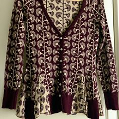 Anthropologie HWR Bohemian plum & cream cardigan This is a beautiful HWR for Anthropologist sweater cardigan in a deep plum & cream combo, with diamond-shaped pearlized (or shell-like) buttons, which flairs out at the bottom, a bit peplum-esque. Measurements can be provided upon request. :) Anthropologie Sweaters Cardigans