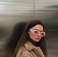 The coat is goals but I'm still undecided about this new retro glasses trend.  Dunno if I really dig it..