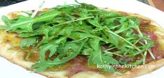 Fig, Caramelized Onion and Prosciutto Flatbread Pizza, Topped with Arugula Salad-tastes JUST like the one they used to have at Nordstrom Bistro