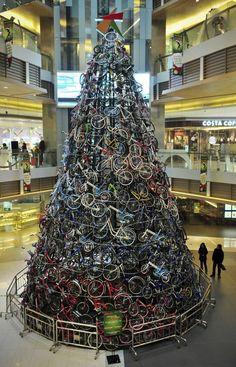 40-foot-tall Christmas tree made of 320 bicycles, on display at a shopping mall in Shenyang, China.
