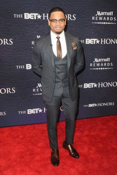 Tristan Wilds in a tailored suit attends the BET Honors awards show. | essence.com