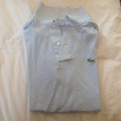 Men's Light Blue Lacoste Short Sleeve Polo Light blue with short sleeves for men. Size 3 similar to size small for men. Sizing chart below. Lacoste Shirts Polos
