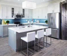Fresh and modern kitchen with rustic floors, barn board trim, grey and white cupboards and large island with white ceaserstone counter. Marble Countertops Cost, Quartz Countertops Colors, Kitchen Countertops, Grey Kitchen Cabinets, Kitchen Cabinet Design, Modern Kitchen Design, White Cupboards, Ikea Kitchen, Kitchen Door Knobs