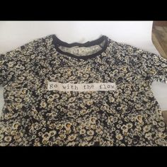 """Go With The Flow"" floral tee- from Spain! NWOT Sleeves go past the elbows. Navy and yellow tiny florals. Never worn- too small for me. I bought this when I studied in Spain, so the brand is not very common in the US! Stradivarius  Tops Tees - Long Sleeve"