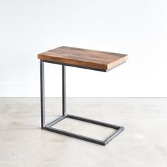 This reclaimed wood c-base accent table is made from 100+ year old reclaimed oak salvaged from a barn in Northern Wisconsin. The hand-welded box frame base is a great solution for small spaces. Slip under your sofa, chair, or bed! We have planed it down and sanded out all its rough edges to leave you a finely finished end table that stands beautifully on its own or as a set!