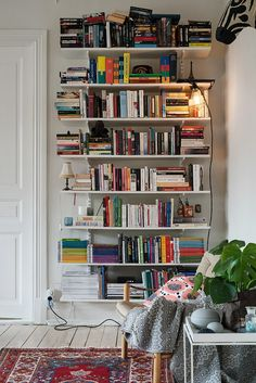 Books! I love books, so I adore the messy, personal look that they can give an entire room.