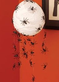 These are some of the spider ideas I have saved. I also remember a spider web being made by painting on a piece of netting and then cutting away the unneeded netting.