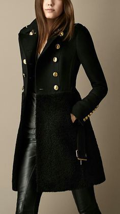 I love the military look of this trench coat! The gold buttons are a nice accent to the all-black fabric.