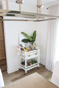 Happy Hour in Paradise: Summer Bar Cart Styling | House Full of Summer - Florida bar cart decor, tropical themed party, tiki bar styling, coastal decor dining room entertaining, LVP wood floors, fresh palm fronds, palm leaves, giant bird of paradise, Bar Cart Styling, Bar Cart Decor, Coastal Homes, Coastal Decor, Decorating On A Budget, Porch Decorating, Pinterest Home, Palm Fronds, Tropical Style