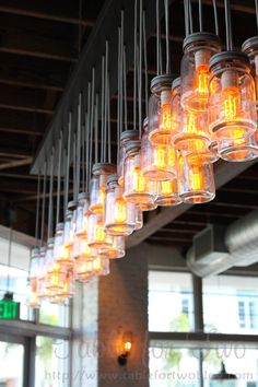 These mason jar lights would be so easy to make and really cool for an outdoor bar area Nice lighting for a restaurant Deco Restaurant, Restaurant Lighting, Restaurant Design, Jar Lights, Bottle Lights, Hanging Lights, Light Fittings, Light Fixtures, Cafe Design