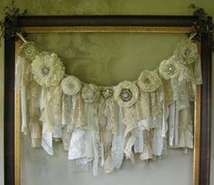 This Shabby Chic Fabric & Lace Garland would make a beautiful backdrop for a Bridal Shower, Wedding Ceremony / Reception, Birthday Party, Anniversary Celebration or most any other Special Event. It could be displayed on the wall, hung from a tree if outdoors or draped from the dessert or gift table.  As a home décor item it would look gorgeous adorning a fireplace mantle, hanging above a headboard or as a window valance just to name a few possibilities.  The knotted portion of the ga...
