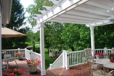 This wood deck with composite rail system incorporates a vinyl pergola that provides lots of shade. Note the use of rail post lighting. Diy Pergola, Pergola Curtains, Metal Pergola, Pergola With Roof, Covered Pergola, Pergola Ideas, Pergola Cover, Outdoor Spaces, Outdoor Decor