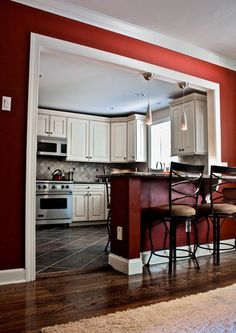 Stunning Red Kitchen Design and Decorating Ideas. Beautiful pictures of modular red color kitchen. See more ideas about Home ideas, My house and Colorful kitchens. Half Wall Kitchen, Kitchen Redo, Living Room Kitchen, Dining Rooms, Kitchen Pass, Kitchen Cabinets, Kitchen Island, Red Kitchen Walls, Dining Area