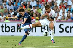 Samir Nasri of France scores their first goal past Steven Gerrard of England during the UEFA EURO 2012 group D match between France and England at Donbass Arena on June 11, 2012 in Donetsk, Ukraine.
