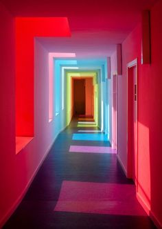 """sixpenceee: """" The effect of colored glass on white walls. This is a nursery school in El Chaparral, Granada, Spain that was designed by Alejandro Muñoz Miranda. Over The Rainbow, Rainbow Light, Rainbow Room, Rainbow River, Rainbow House, Neon Lighting, Corridor Lighting, Lighting Ideas, White Walls"""