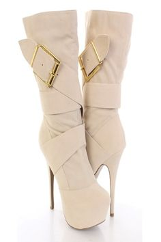 Look fabulous and adorable in these high fashion boot heels! Heads will turn when you walk in the room with these! You could dress them up with your favorite dress or keep it casual with your favorite skinnies. Make sure you add these to your closet, it definitely is a must have! The features include faux suede upper with a wrap around strap design, large side buckle accent, stitched detailing, side zipper closure, smooth lining, and cushioned footbed. Approximately 6 inch heels, 2 inch…
