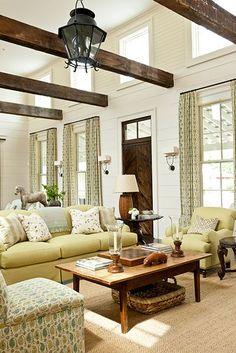 Elegant living room. family room, den interior design ideas and home decor.. with beamed ceiling ..