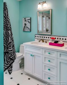 Zebra striped blue bathroom