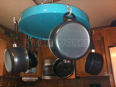 Recycled 55 gallon steel drum pot rack, can be had in any color, but this example is turquoise powder coated finish. Holds five pots and pans, plus it can hold a potted plant in the center at the same time for a great and unique display.