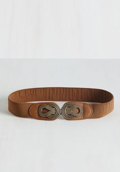 Boldly Buckled Belt in Cognac. All it takes to turn an understated outfit up a notch is hooking this cognac-brown belt around your waistline! #tan #modcloth