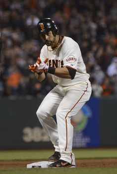 Angel Pagan #16 of the San Francisco Giants stands on third base celebrating after hitting an RBI triple in the eighth inning against the Colorado Rockie at AT Park on September 18, 2012 in San Francisco, California. The Giants won the game 6-3.