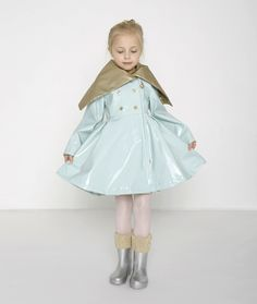 Children's raincoats tend to veer on the sweet, playful side. And why wouldn't they? We want kids to enjoy their time outdoors, even in the rain. Oil & Water's fall 2014 outerwear is sweet and playful too. And more: it may be the only rainwear collection in the market that's glamorous. The Riding Poncho comes in a glimmering aqua edged in bronze with a generous hood. The garment reverses to a luxuriously soft faux leopard textile. www.oilandwater.com (designer preview)