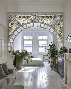 stained glass arch in interior designer anouk Taeymans' Art Nouveau apartmen. - Inspirational Interior Design Ideas for Living Room Design, Bedroom Design, Kitchen Design and the entire home. Belle Epoque, Foyer Design, Deco Design, House Design, Design Bedroom, Home Arch Design, Dream Home Design, Design Art, Floral Design