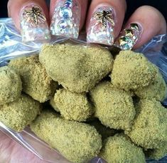 Cute nails clutching nice nugs! Smoking isn't the only way to enjoy marijuana. Try small edible marijuana candies you make yourself. MARIJUANA - Guide to Buying, Growing, Harvesting, and Making Medical Marijuana Oil and Delicious Candies to Treat Pain an