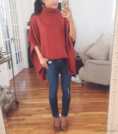 Fall casual outfit: pumpkin poncho sweater, skinny jeans + leopard heels