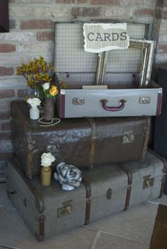 Vintage Suitcases for a Steam Punk wedding at Old Thorns Liphook! Steam Punk Wedding Flowers, designed and created by Hannah Berry Flowers based in Farnham Surrey www.hannahberryflowers.co.uk