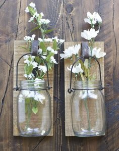 Use this Hanging Canning Jar to display fresh flowers, votive candles or your other treasures! Hanging jars sold individually. Made of wood and iron. Handle i