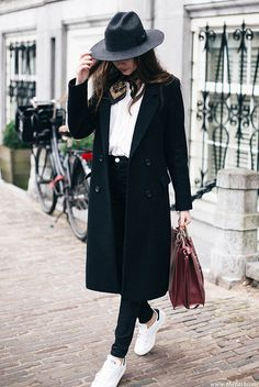 Street Style - The Top Blogger Looks Of The Week: Fashion blogger 'The Fashion Cuisine' wearing a black long blazer, a white t-shirt, black high waist skinny jeans, white sneakers, a black silk scarf, a black wide brim hat and a burgundy handbag. Fall outfit, sneakers outfit, comfy outfit, athleisure, tomboy outfit, winter outfit.