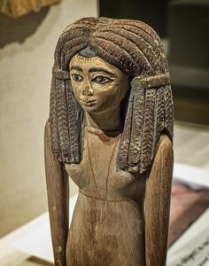 Closeup of wooden figurine of a woman Egypt Middle Kingdom 12th Dynasty 1900-1800 BCE