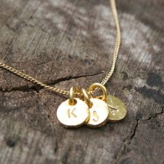 Gold Monogram Necklace / Three Hand Stamped Initials Tag Coin Disc Charm Necklace, via Etsy.