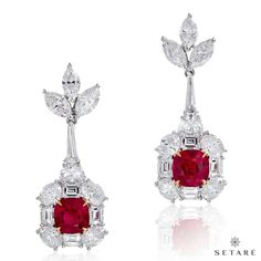 """A magnificent platinum earrings set with cushion-cut Burmese rubies or """"Pigeon's blood ruby"""", is among the rarest of all gemstones."""