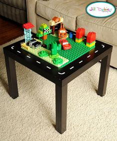 DIY Lego table-buy a small side table, adhere a Lego mat-very smart! (To do with our old side table.)
