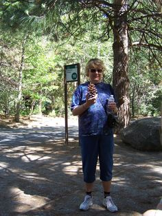 2012, Carol holding up some large pinecones that she found.  doubt she took them.  Yosemite Natn'l Park, CA