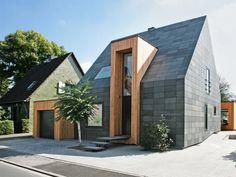 In der modernen Architektur sind Verkleidungen in Mode, die Dach und Wand wie aus einem Guss erscheinen lassen.