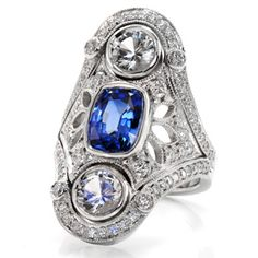 Delicate and vintage inspired wide #EngagementRing with micropave diamonds and blue sapphire center. Design 2224 from #KnoxJewelers