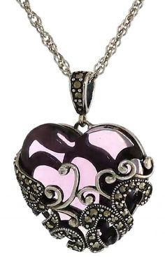 Amazon Collection Sterling Silver Gemstone Heart Pendant Necklace features a heart-shaped glass stone incased in marcasite-accented filigree, with a marcasite-accented bail suspended by rope chain.There are more than 30 small marcasite gemstones!