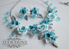 Floral polymer clay necklace and earrings set by Stamarina on Etsy