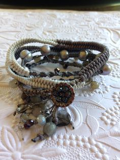 Micro macrame bracelet made using My Knotty Do It All board. 5 wraps with silver pearls, Labradorite beads, silvers and grays with a vintage button.