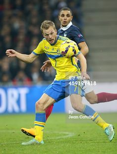 Sebastian Larsson of Sweden and Layvin Kurzawa of...