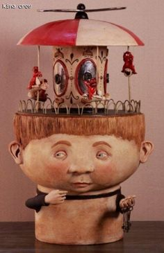 """A.ma.zing! This would look so good in my dining room! Kina Crow  31 """" x 16 """" x 16 """" Ceramic, metal and wood turntable.   the carousel in the head of this big boy does actually move."""