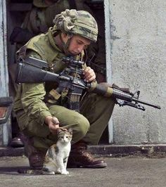 The PERFECT soldier - BAMF with a big a** gun but still takes the time to scratch the ear of an adorable little kitten.