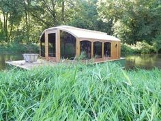 Man Designs Micro Houseboat You Can Build for Cheap Photo