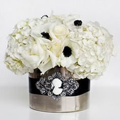 Chic arrangement of white hydrangea, white roses and black + white anemones
