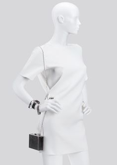 NEXT is a line of semi- abstract female mannequins #FemaleMannequins #whitesculpture #minimalism #metalaccesories